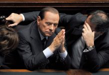 Italian Prime Minister Silvio Berlusconi (L) reacts during a session of the Italian parliament on September 14, 2011 in Rome. Italy's Chamber of Deputies endorsed the government's 54.2 billion euro ($74 billion) austerity package aimed at calming skittish markets amid a European debt crisis, with a total of 316 deputies voted in favour while 302 voted against. AFP PHOTO / ALBERTO PIZZOLI (Photo credit should read ALBERTO PIZZOLI/AFP/Getty Images)