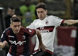 Davide Calabria and Emanuele Giaccherini during Bologna-Milan at Stadio Renato Dall'Ara on the 7th of May 2016 (@acmilan.com)