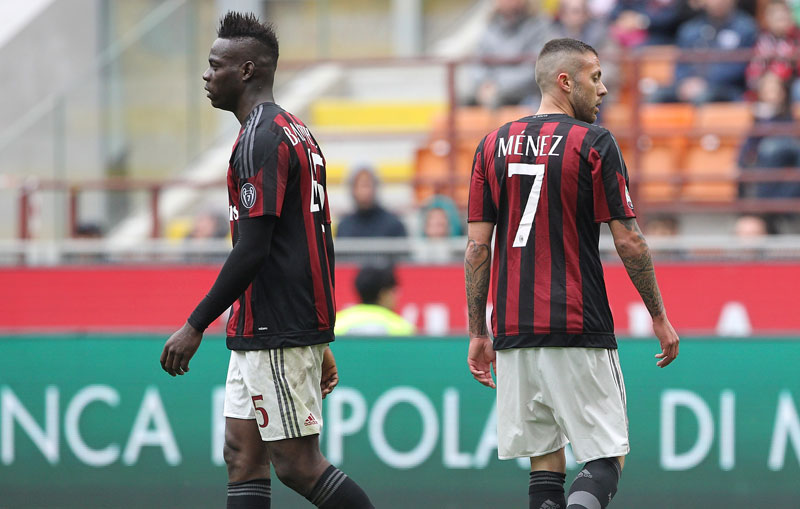 Mario Balotelli (L) and Jeremy Menez (R) of AC Milan show their dejection during the Serie A match between AC Milan and Frosinone Calcio at Stadio Giuseppe Meazza on May 1, 2016 in Milan, Italy. (Photo by Marco Luzzani/Getty Images)
