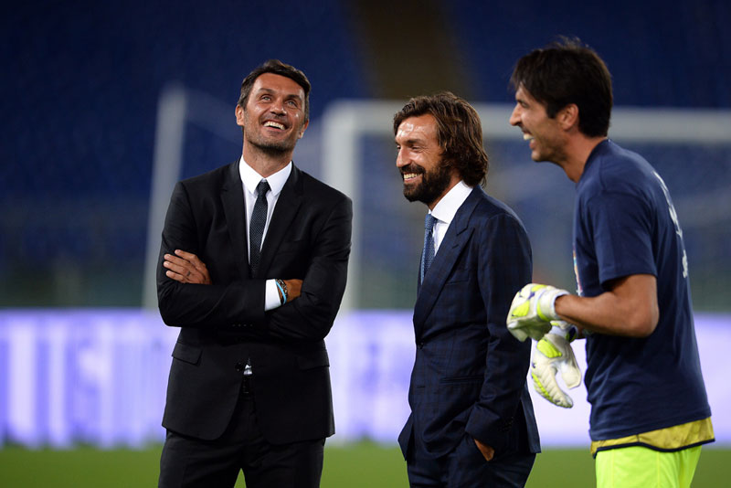 "Italy's Paolo Maldini (L) Andrea Pirlo, Gianluigi Buffon stand during the inter religious ""match for peace"" football game in Rome's Olympic Stadium on September 1, 2014. AFP PHOTO/Filippo MONTEFORTE (Photo credit should read FILIPPO MONTEFORTE/AFP/Getty Images)"