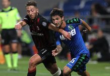 Matteo Politano (R) of US Sassuolo Calcio is challenged by Andrea Bertolacci (L) of AC Milan during the TIM Preseason Tournament at Mapei Stadium - Citta' del Tricolore on August 10, 2016 in Reggio nell'Emilia, Italy (Photo by Marco Luzzani/Getty Images)