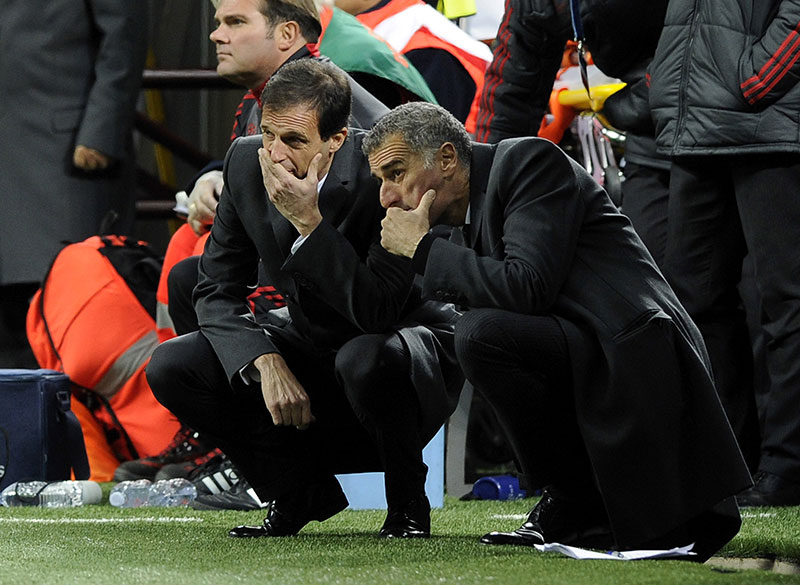 Massimiliano Allegri (L) speaks with his assistant Mauro Tassotti of AC Milan during the UEFA Champions League group C match between AC Milan and Malaga CF at Stadio Giuseppe Meazza on November 6, 2012 in Milan, Italy. (Photo by Claudio Villa/Getty Images)