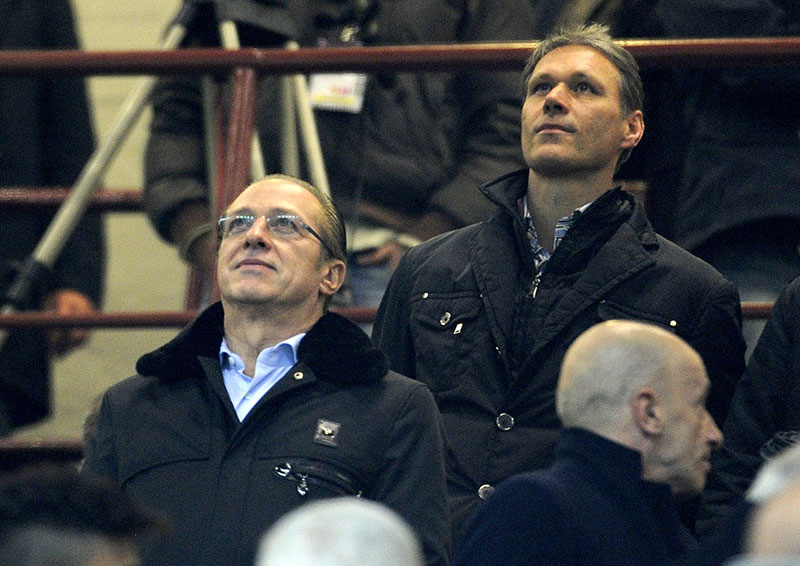 Paolo Berlusconi (L) and Marco Van Basten attend the Serie A match between AC Milan and Juventus FC at San Siro Stadium on November 25, 2012 in Milan, Italy. (Photo by Claudio Villa/Getty Images)
