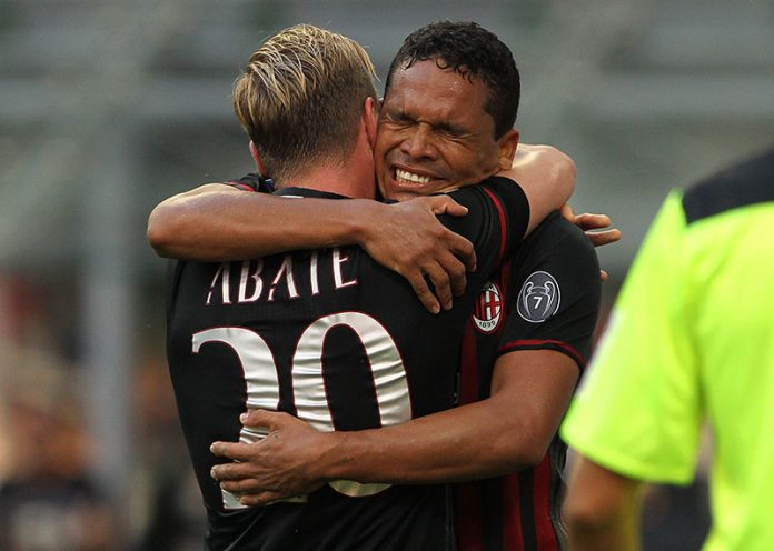 Carlos Bacca (R) of AC Milan celebrates with his team-mate Ignazio Abate (L) after scoring the opening goal during the Serie A match between AC Milan and FC Torino at Stadio Giuseppe Meazza on August 21, 2016 in Milan, Italy. (Photo by Marco Luzzani/Getty Images)