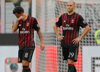 AC Milan's Spanish midfielder Suso (L) and AC Milan's defender Gabriel Paletta react at the end of the Italian Serie A football match AC Milan Vs Udinese on September 11, 2016 at the San Siro stadium in Milan. / AFP / MARCO BERTORELLO (Photo credit should read MARCO BERTORELLO/AFP/Getty Images)