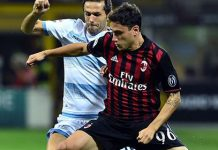 AC Milan's Italian defender Davide Calabria (R) vies for the ball with Lazio's Bosnian midfielder Senad Lulic during the Italian Serie A football match between AC Milan and SS Lazio at the San Siro Stadium in Milan, on September 20, 2016. / AFP / Giuseppe CACACE (Photo credit should read GIUSEPPE CACACE/AFP/Getty Images)
