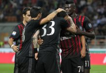 Carlos Bacca #70 of AC Milan celebrates with his team-mates after scoring the opening goal during the Serie A match between AC Milan and SS Lazio at Stadio Giuseppe Meazza on September 20, 2016 in Milan, Italy. (Photo by Marco Luzzani/Getty Images)
