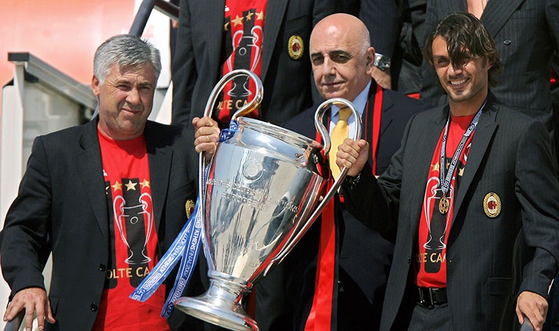 Carlo Ancellotti (L), President Adriano Galliani and captain Paolo Maldini hold the Champions League trophy as they arrive at Milan Malpensa Airport, 24 May 2007. AC Milan won the European Champions League title in Athens, yesterday, beating Liverpool 2-1. AFP PHOTO / FILIPPO MONTEFORTE (Photo credit should read FILIPPO MONTEFORTE/AFP/Getty Images)