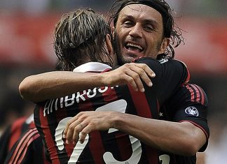 AC Milan's defender and captain Paolo Maldini (R) celebrates with teammate Massimo Ambrosini who scored a goal against AS Roma during their Serie A football match in Milan's San Siro Stadium on May 24, 2009. After 24 seasons as one of Italy's finest defenders and AC Milan's emblem, Paolo Maldini finally bids farewell to his adoring home fans, playing today his last game. AFP PHOTO / FILIPPO MONTEFORTE (Photo credit should read FILIPPO MONTEFORTE/AFP/Getty Images)