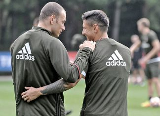 Luca Antonelli and Gianluca Lapadula in training (@acmilan.com)