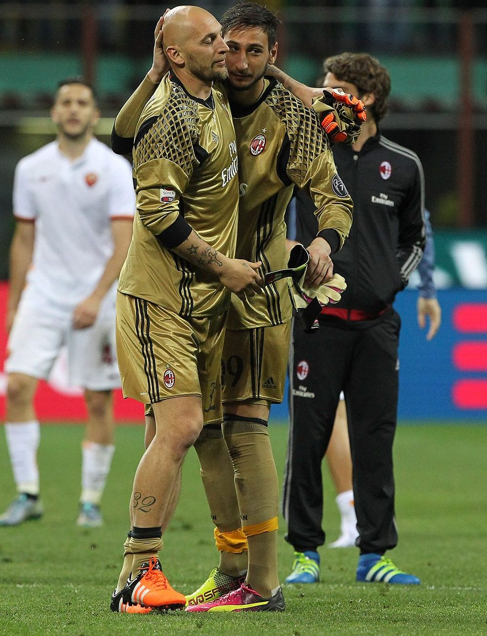 Christian Abbiati of AC Milan embraces Gianluigi Donnarumma at the end of the Serie A match between AC Milan and AS Roma at Stadio Giuseppe Meazza on May 14, 2016 in Milan, Italy. (Photo by Marco Luzzani/Getty Images)