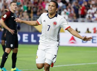 Carlos Bacca #7 of Colombia celebrates his first half goal ahead of Matt Besler #5 of United States during the 2016 Copa America Centenario third place match at University of Phoenix Stadium on June 25, 2016 in Glendale, Arizona. (Photo by Christian Petersen/Getty Images)