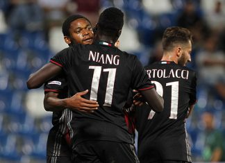 M' Baye Niang (R) of AC Milan celebrates his goal with his team-mate Luiz Adriano (L) during the TIM Preseason Tournament at Mapei Stadium - Citta' del Tricolore on August 10, 2016 in Reggio nell'Emilia, Italy (Photo by Marco Luzzani/Getty Images)
