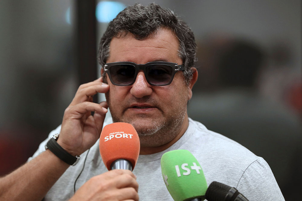Mino Raiola speaking to journalists on September 2, 2016 (VALERY HACHE/AFP/Getty Images)