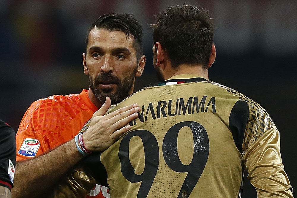 Buffon and Donnarumma at the end of Milan-Juventus at Stadio San Siro on the 22nd of October 2016 (MARCO BERTORELLO/AFP/Getty Images)
