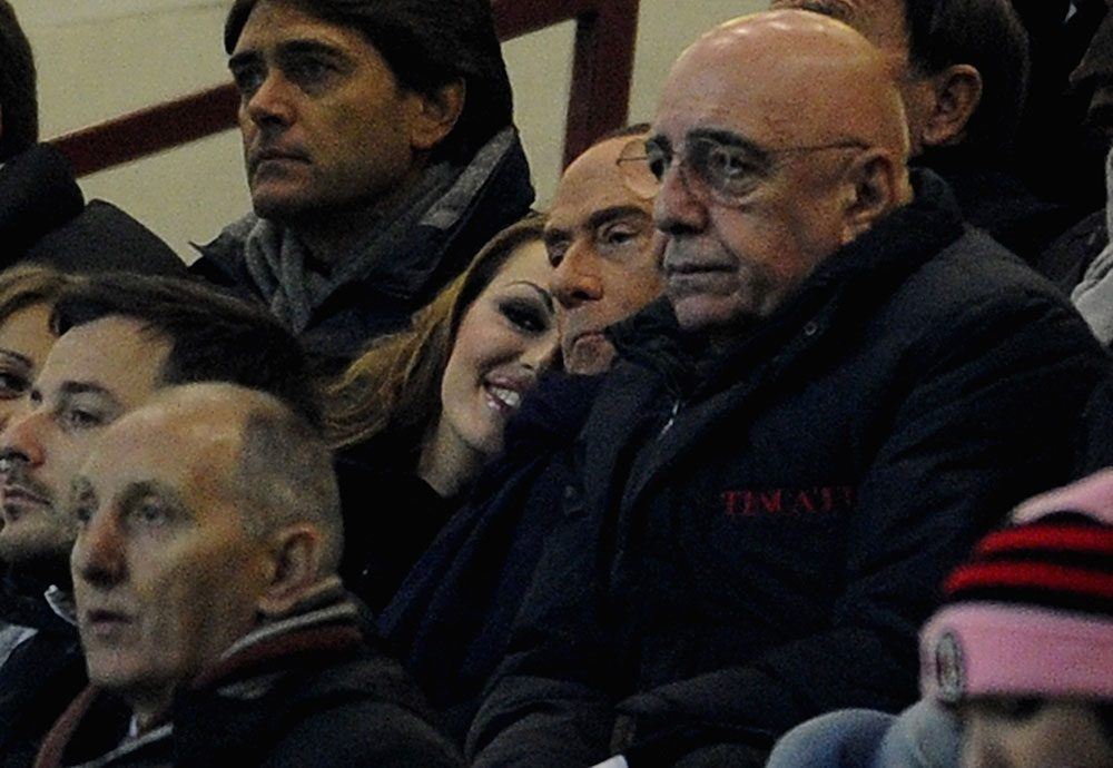 Galliani with Silvio Berlusconi and Francesca Pascale during Milan-Zenit at San Siro Stadium on the 4th of December 2012. (Photo by Claudio Villa/Getty Images)