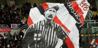 Milan fans waving a flag with Herbert Kilpin's image before Torino-Milan at Stadio Olimpico di Turin on the 10th of January 2015 (MARCO BERTORELLO/AFP/Getty Images)