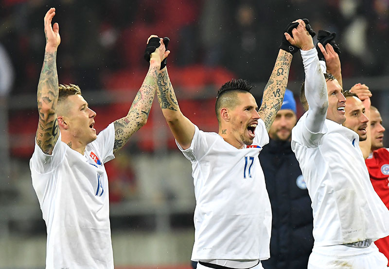 Juraj Kucka, Marek Hamsik and Jan Durica celebrate at the end of the Slovakia-Lithuania at Štadión Antona Malatinského on the 11th of November 2016 (JOE KLAMAR/AFP/Getty Images)