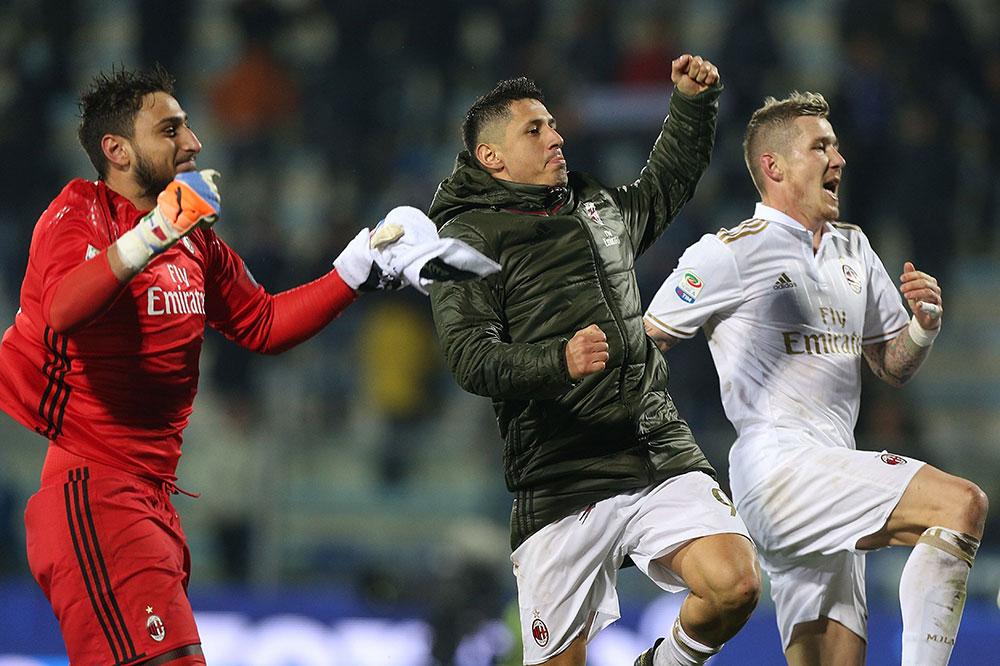 Lapadula, Gianluigi Donnarumma and Juraj Kucka of AC Milan celebrates at the end of Empoli-Milan at Stadio Carlo Castellani on the 26th of November 2016. (Photo by Gabriele Maltinti/Getty Images)