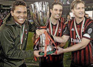 Ignazio Abate, Giacomo Bonaventura and Carlos Bacca celebrating with the Supercoppa Italiana trophy at the Jassim Bin Hamad Stadium on the 23rd of December 2016. (@acmilan.com)