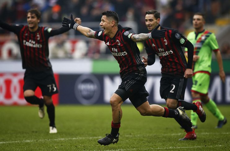 AC Milan's forward Giacomo Lapadula (C) celebrates with teammates after scoring during the Italian Serie A football match AC Milan Vs Crotone on December 4, 2016 at the 'San Siro Stadium' in Milan. / AFP / MARCO BERTORELLO (Photo credit should read MARCO BERTORELLO/AFP/Getty Images)