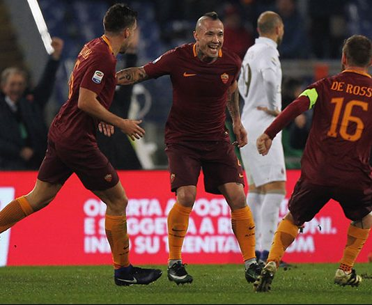 Radja Nainggolan, Kevin Strootman and Daniele De Rossi celebrating Roma's winner during Roma-Milan at Stadio Olimpico on the 12th of December 2016 (Photo by Paolo Bruno/Getty Images )