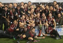 Milan team poses for the group photo after winning the Supercoppa TIM Doha 2016 match between Juventus FC and AC Milan at the Jassim Bin Hamad Stadium on December 23, 2016 in Doha, Qatar. (Photo by AK BijuRaj/Getty Images)