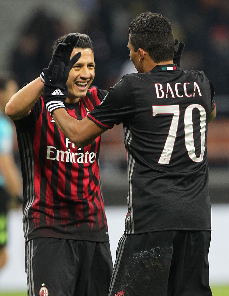 Carlos Bacca and Gianluca Lapadula celebrating against Cagliari at Stadio San Siro on the 8th of January 2017 (Photo by Marco Luzzani/Getty Images)