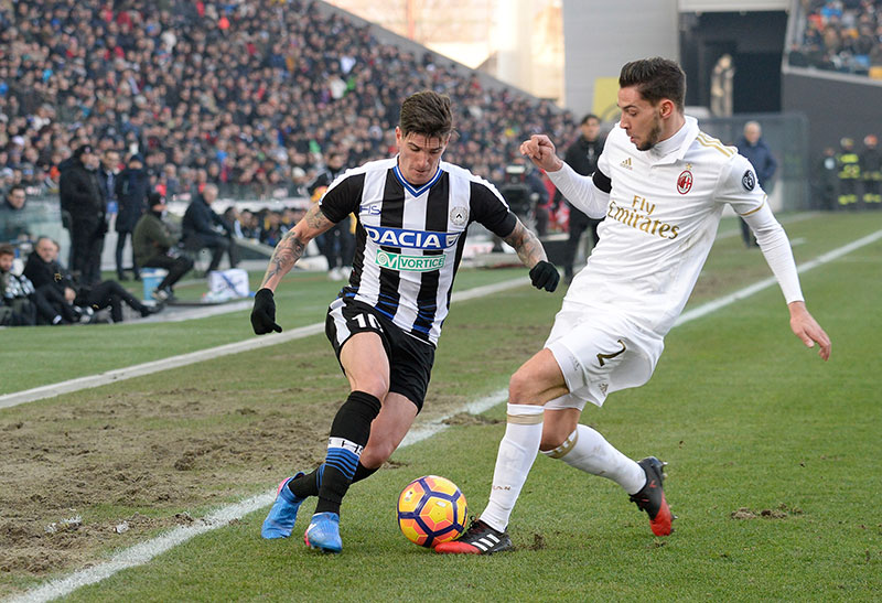 Mattia De Sciglio and Rodrigo De Paul during Udinese-Milan at Stadio Friuli on the 29th of January 2017 (Photo by Dino Panato/Getty Images)