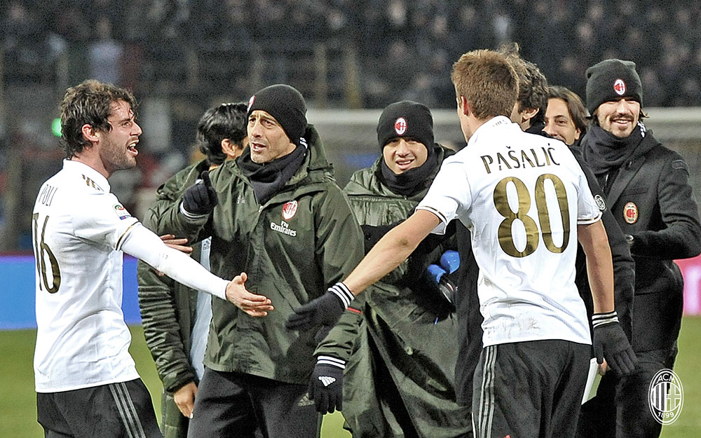 Andrea Poli and Mario Pasalic celebrating with Milan staff and players at the end of Bologna-Milan at Stadio Renato Dall'Ara on the 8th of February 2017. (@acmilan.com)
