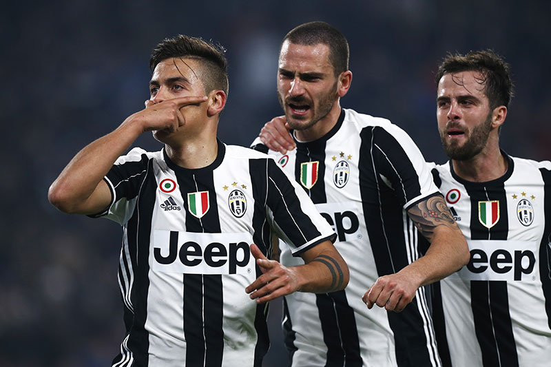 Paulo Dybala, Leonardo Bonucci and Miralem Pjanic celebrate during Juventus-Napoli at the Juventus Stadium on the 28th of February 2017. (MARCO BERTORELLO/AFP/Getty Images)