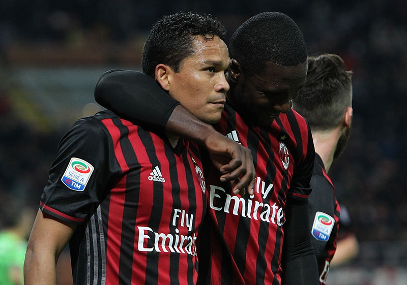 Carlos Bacca and Cristian Zapata celebrate Bacca's second goal during Milan-Chievo at Stadio San Siro on the 4th of March 2017. (Photo by Marco Luzzani/Getty Images)