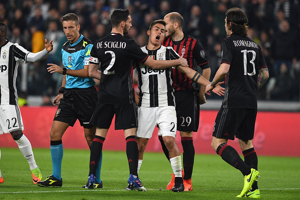 Paulo Dybala, Mattia De Sciglio, Alessio Romagnoli, Gabriel Paletta and referee Davide Massa during Juventus-Milan at the Juventus Stadium on the 10th of March 2017. (Photo by Valerio Pennicino/Getty Images)