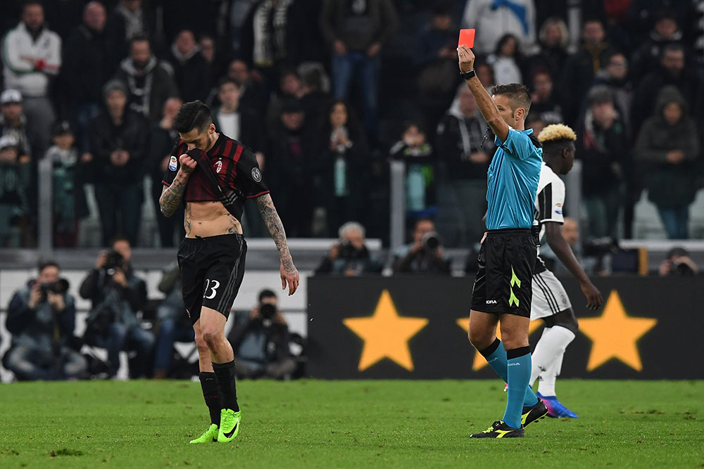 Jose Sosa receiving a red card from referee Davide Massa during Juventus-Milan at the Juventus Stadium on the 10th of March 2017. (Photo by Valerio Pennicino/Getty Images)