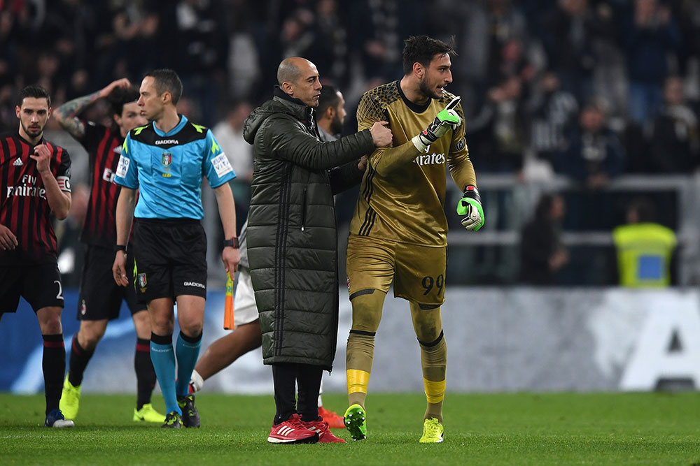 Gianluigi Donnarumma reacting against the assistant referee at the end of Juventus-Milan at the Juventus Stadium on the 10th of March 2017. (Photo by Valerio Pennicino/Getty Images)
