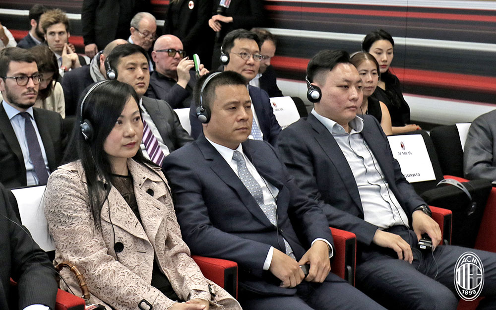 Yonghong Li (C) and Han Li (R) listening during Marco Fassone's press conference at Casa Milan on the 14th of April 2017. (@acmilan.com)