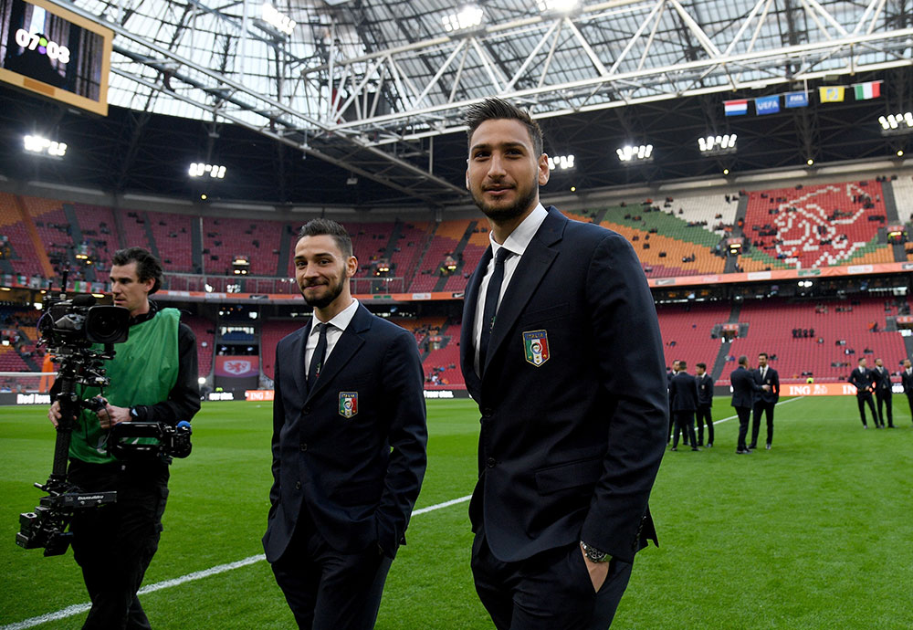 Donnarumma and De Sciglio prior to Netherlands-Italy at Amsterdam Arena on the 28th of March 2017. (Photo by Claudio Villa/Getty Images)