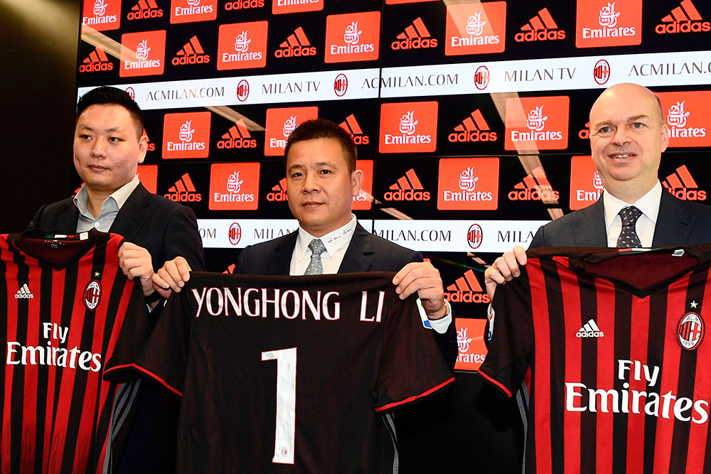 Han Li (L), Yonghong Li (C) and Marco Fassone (R) during a press conference at Casa Milan on the 14th of April 2017. (MIGUEL MEDINA/AFP/Getty Images)