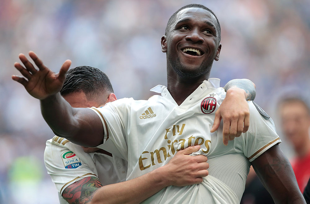 Cristian Zapata and Gianluca Lapadula celebrating during Inter-Milan at Stadio San Siro on the 15th of April 2017. (Photo by Emilio Andreoli/Getty Images)