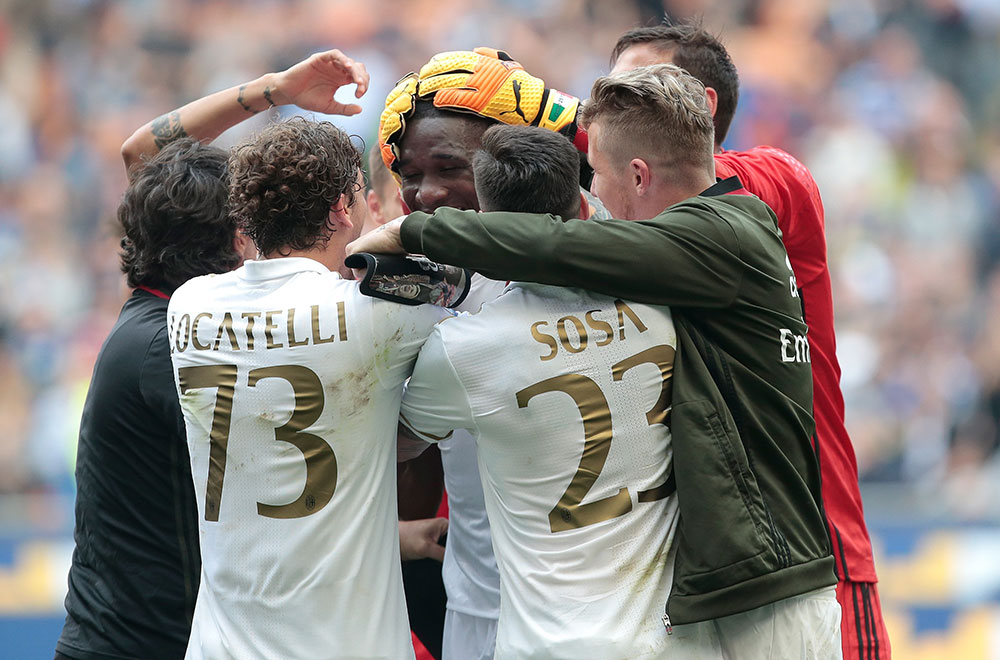 Cristian Zapata congratulated by his teammates after Inter-Milan at Stadio San Siro on the 15th of April 2017. (Photo by Emilio Andreoli/Getty Images)