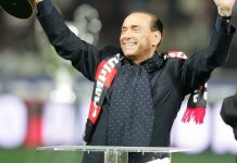 Silvio Berlusconi holds up the FIFA Club World Cup before Milan-Napoli at the San Siro on the 13th of January 13. (Photo by Newpress/Getty Images)
