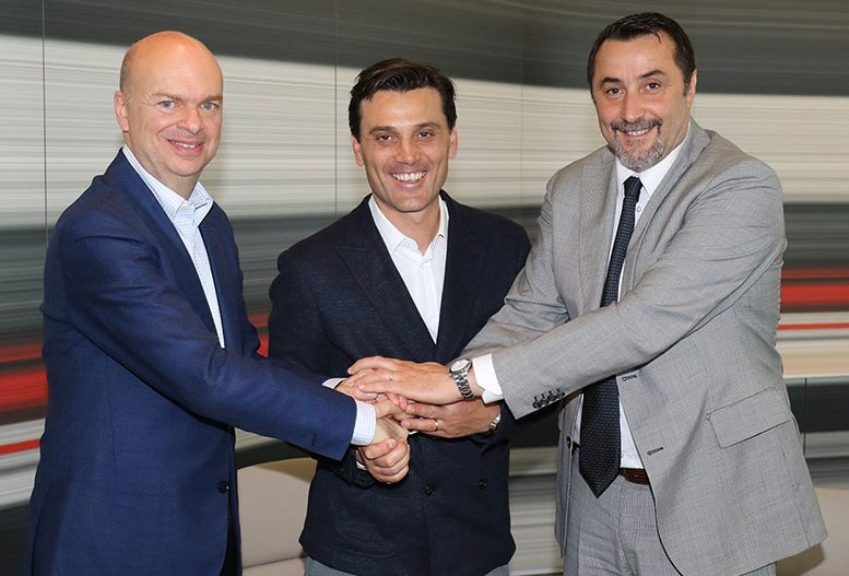 Marco Fassone, Vincenzo Montella and Massimiliano Mirabelli after the coach signed a renewal at Casa Milan on the 30th of May 2017. (@acmilan.com)