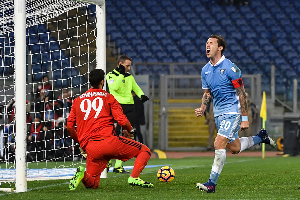 Lucas Biglia celebrates after scoring a penalty against Gianluigi Dinnarumma during Lazio-Milan at Stadio Olimpico on February 13, 2017. (ANDREAS SOLARO/AFP/Getty Images)