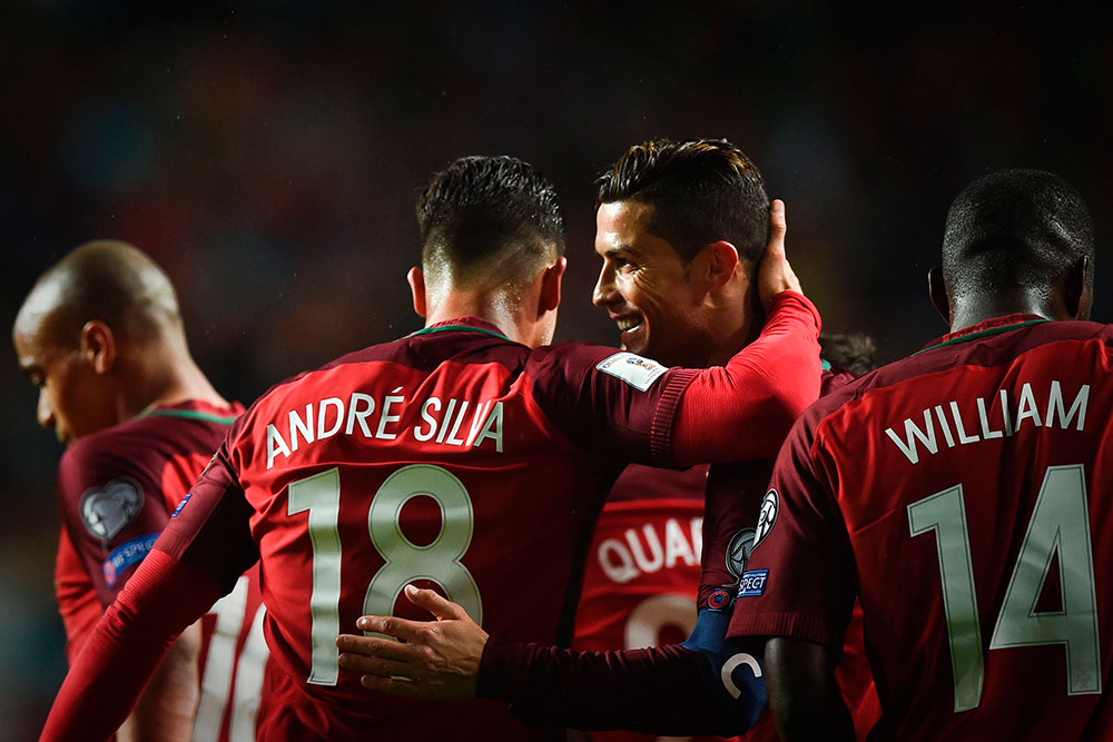 André Silva and Cristiano Ronaldo celebrate during Portugal-Hungary at the Luz Stadium on March 25, 2017. (PATRICIA DE MELO MOREIRA/AFP/Getty Images)