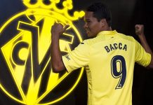 Carlos Bacca with a Villarreal shirt (via villarrealcf.es)