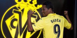 Carlos Bacca with a Villarreal shirt (via villarrealcf.es)