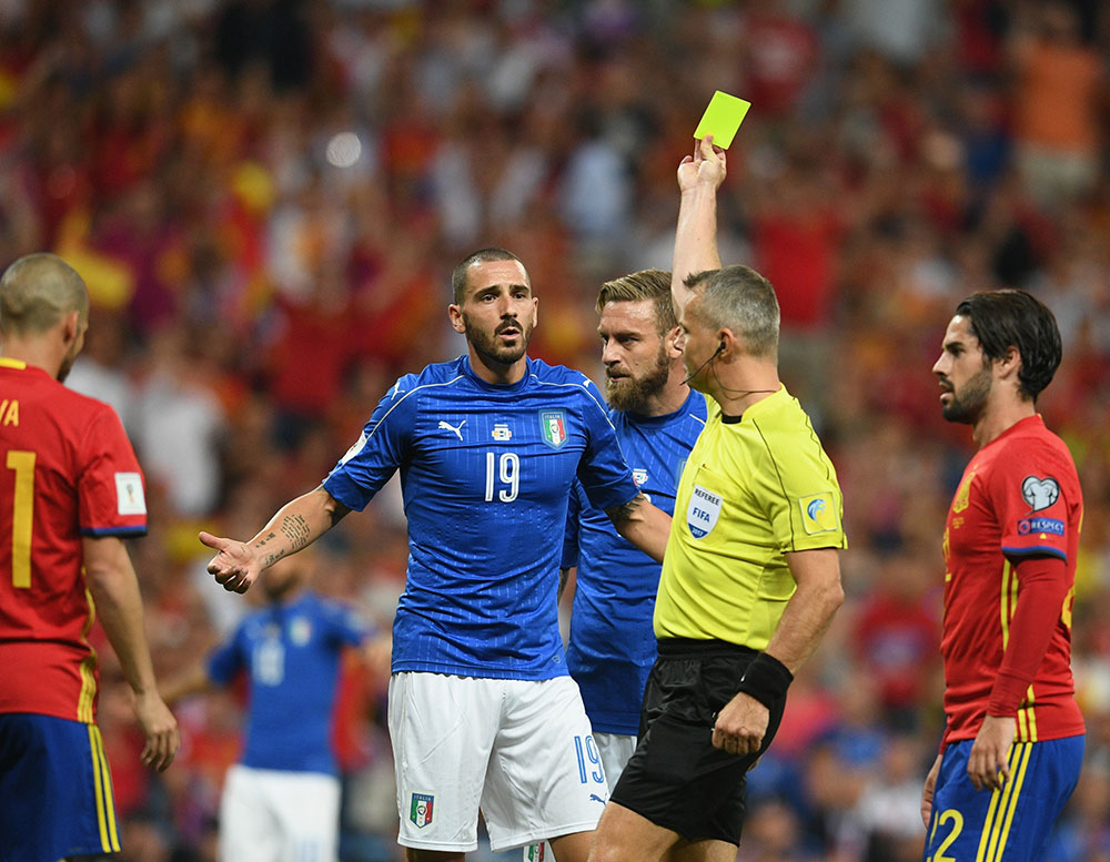 Leonardo Bonucci getting booked by referee Bjorn Kuipers during Spain-Italy at Estadio Santiago Bernabeu on September 2, 2017. (Photo by Claudio Villa/Getty Images)
