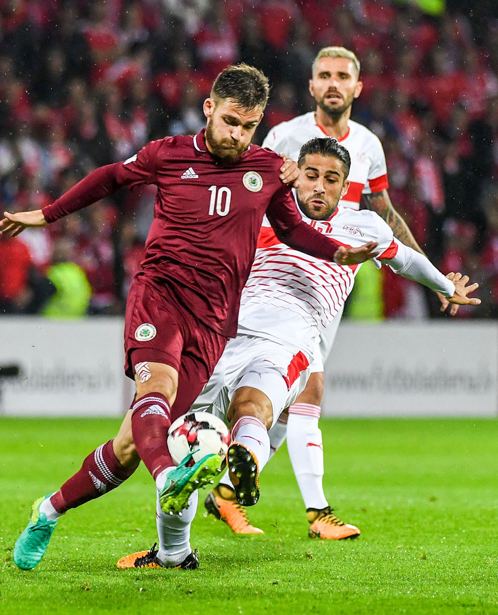 Ricardo Rodriguez and Valerijs Sabala during Latvia-Switzerland at Stadions Skonto on September 3, 2017. (ILMARS ZNOTINS/AFP/Getty Images)