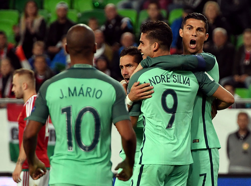 André Silva celebrates with Cristiano Ronaldo and João Mário during Hungary-Portugal at The Grupama Arena in Budapest on September 3, 2017. (ATTILA KISBENEDEK/AFP/Getty Images)