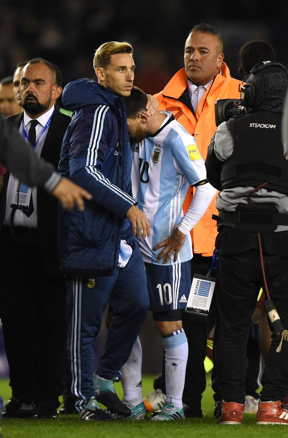 Lucas Biglia and Lionel Messi at the end of Argentina-Venezuela at Estadio Monumental Antonio Vespucio Liberti on September 5, 2017. (EITAN ABRAMOVICH/AFP/Getty Images)